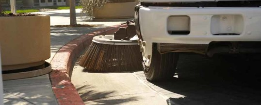 Milpitas parking lot sweeping and puddle clean up by Universal Site Services.