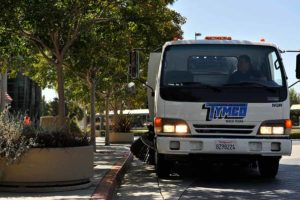 Universal Site Services providing angled parking lot sweeping service.