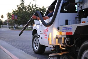 Sweeping truck cleaning gutters in Long Beach