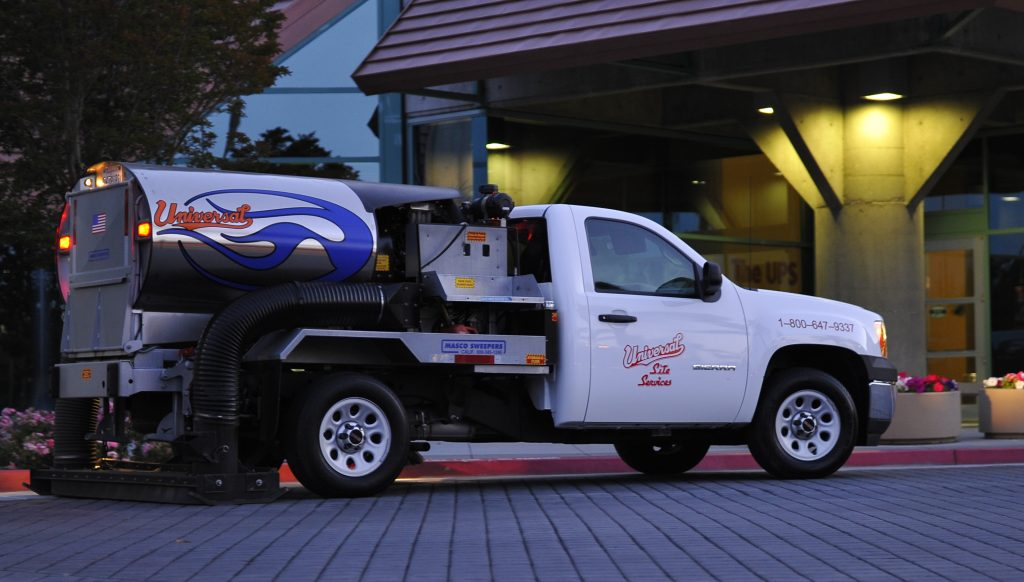 Universal Site Services work truck performing parking lot sweeping in Yorba Linda