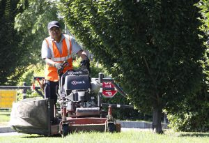 mowing the green space of a commercial landscaping job by universal site services