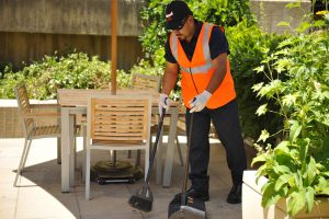 image of a day porter in northridge sweeping a common area