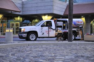 USS parking lot sweeping in northridge truck in action cleaning a retail lot